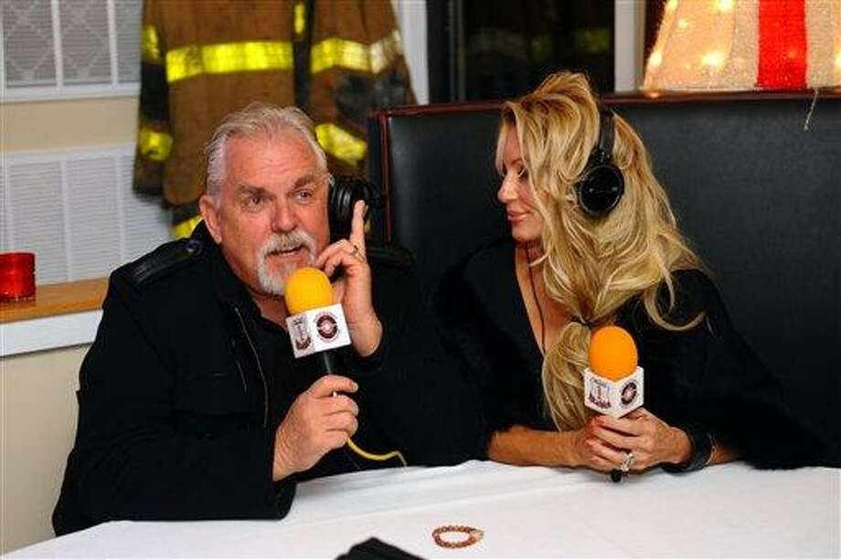 FOR USE IN WEEKEND EDITIONS DEC. 15-16 - In this Dec. 6, 2012 photo, actor John Ratzenberger, a Bridgeport native, and his wife Julie take part in a live radio broadcast in Bridgeport, Conn. (AP Photo/Connecticut Post, Christian Abraham) MANDATORY CREDITY Photo: AP / Connecticut Post