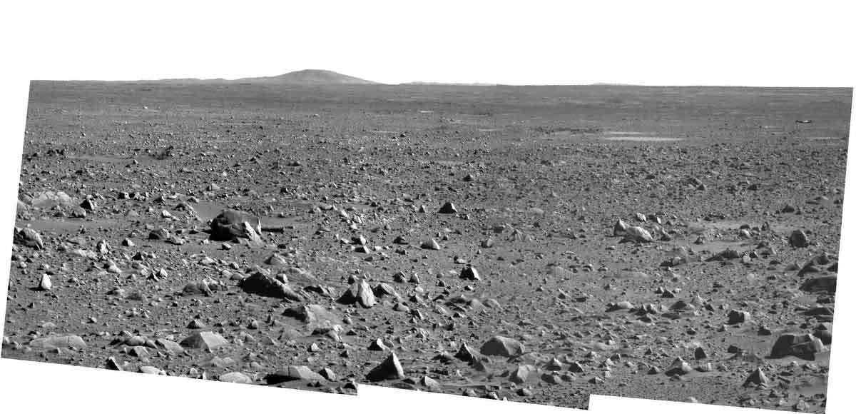 This panoramic view taken by the Mars Spirit rover on March 31, 2004 and released by NASA on April 2, 2004 shows the rock-strewn path the rover has taken from its landing site since touching down on Mars on Jan. 3, 2004. Spirit's lander is in the far upper right of the image. The hill on the horizon is Grissom Hill. The Spirit rover completed its primary mission to Mars on Monday, April 5, 2004, and will continue to explore the planet. (AP Photo/ NASA/JPL/Cornell)