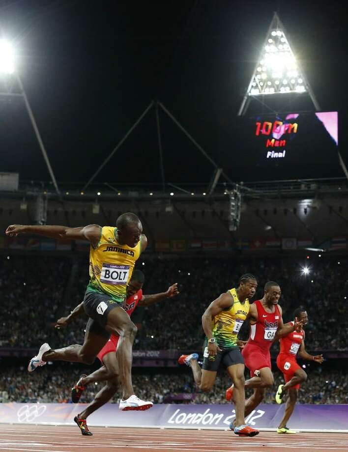 Jamaica's Usain Bolt, left, crosses the finish line ahead of, from second left, United States' Justin Gatlin, Jamaica's Yohan Blake, United States' Tyson Gay, and Trinidad's Richard Thompson in the men's 100-meter final during the athletics in the Olympic Stadium at the 2012 Summer Olympics in London on Sunday. Associated Press
