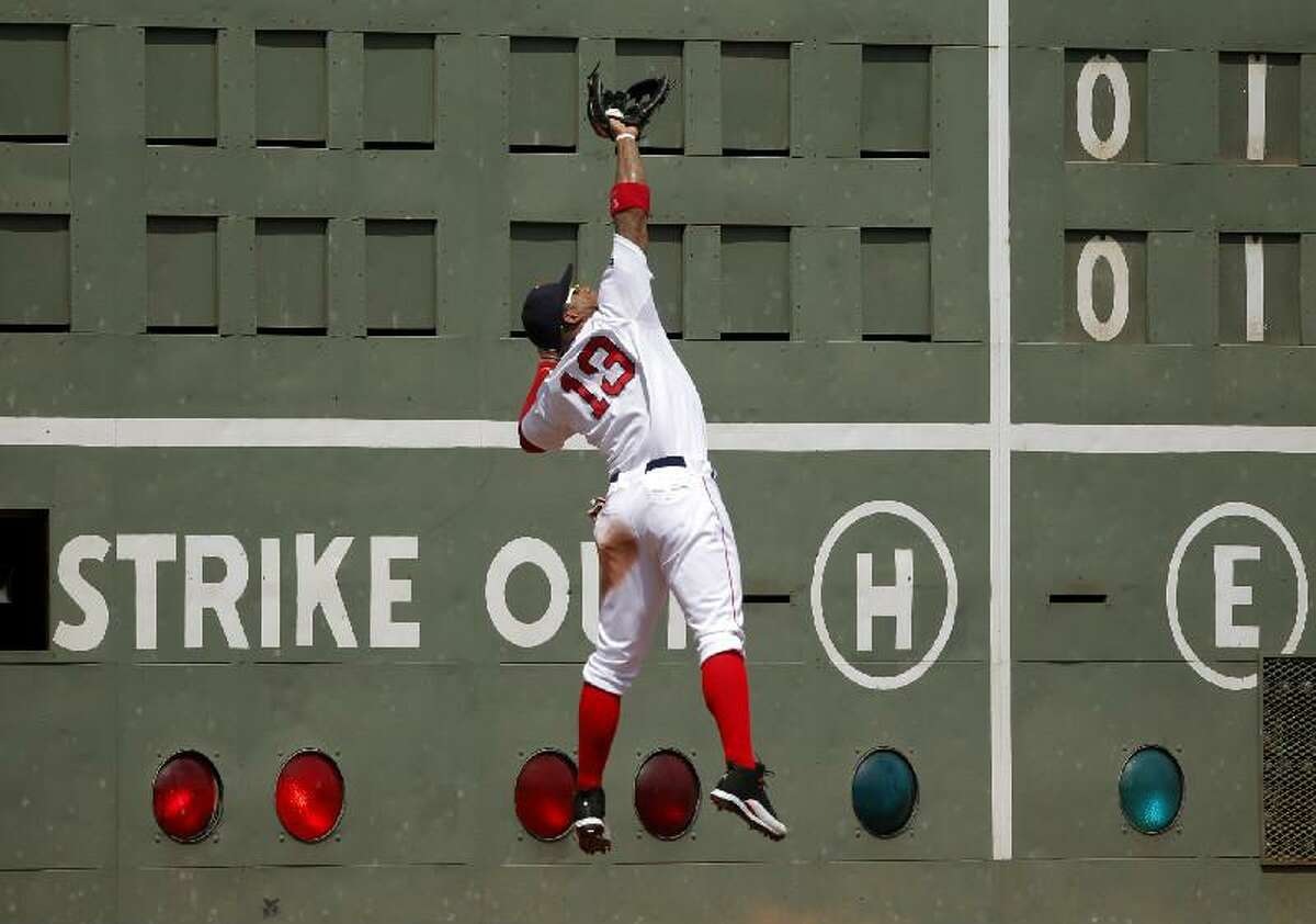 ASSOCIATED PRESS Boston Red Sox left fielder Carl Crawford makes a catch on a ball hit by Minnesota Twins' Ryan Doumit in the second inning of Sunday's game at Fenway Park in Boston.