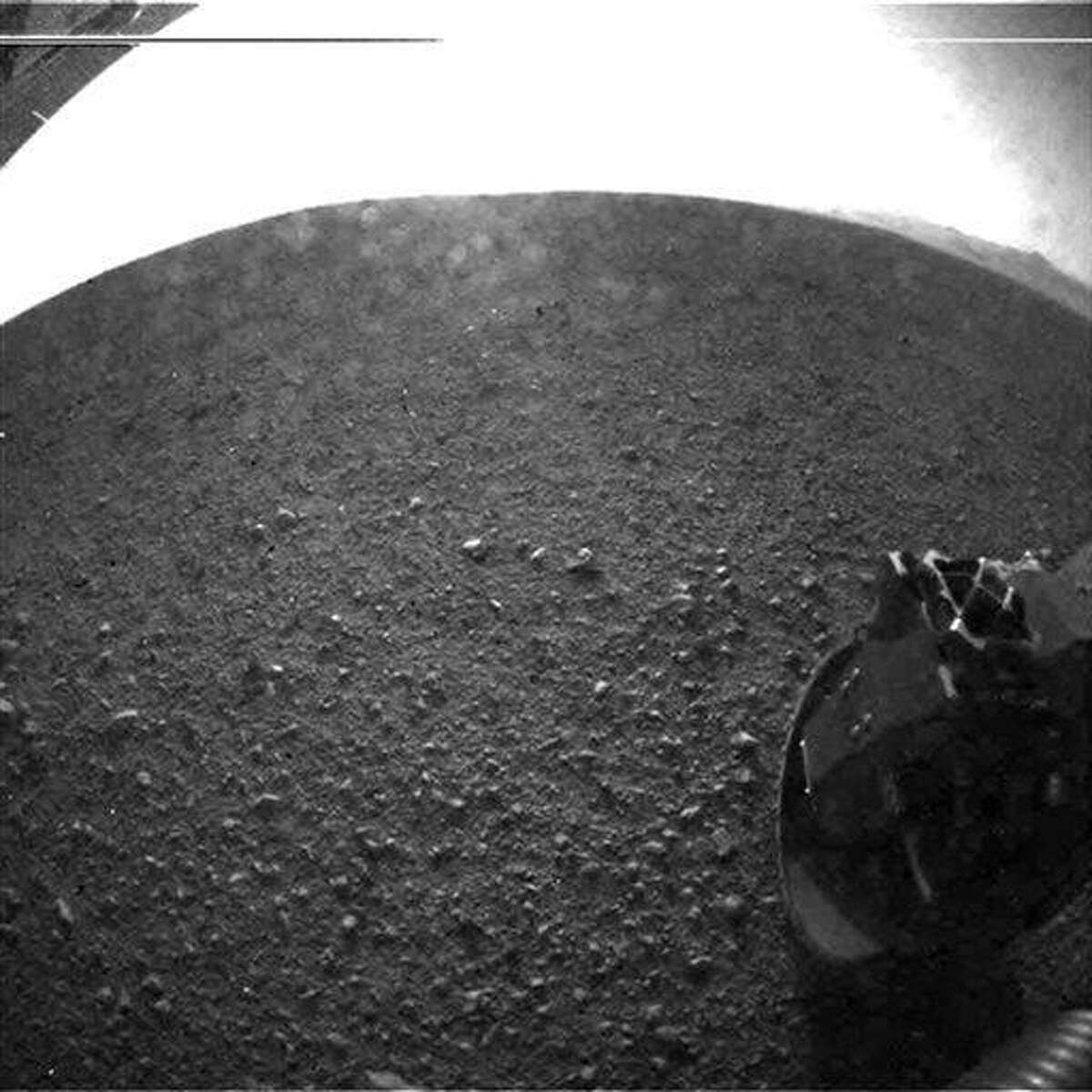 In this photo released by NASA's JPL, this is one of the first images taken by NASA's Curiosity rover, which landed on Mars. It was taken with a
