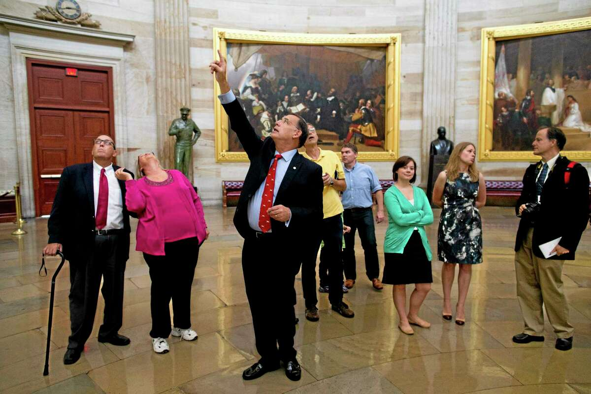 Sen. John Boozman, R-Ark., leads a tour in the Rotunda on Capitol Hill in Washington on Thursday, Oct. 3, 2013. Congressional staffers and interns usually lead constituent tours, but due to the federal government shutdown members of Congress have begun to lead tour groups from their home states. (AP Photo/ Evan Vucci)