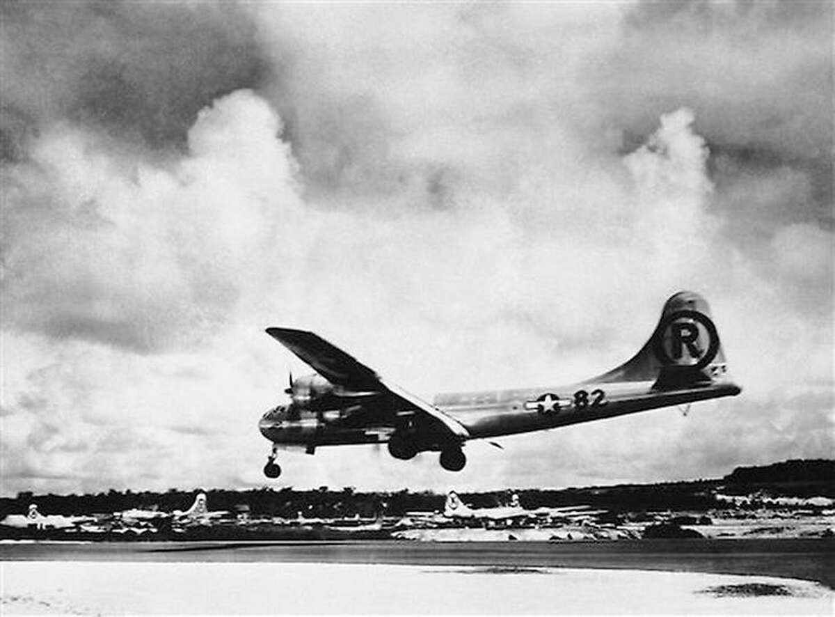 """One of the U.S. Air Force's most famous war planes, the Boeing B29 Super fortress """"Enola Gay"""" lands at its Tinian Base after the historic atomic bombing mission against the Japanese city of Hiroshima on August 6, 1945. Associated Press"""
