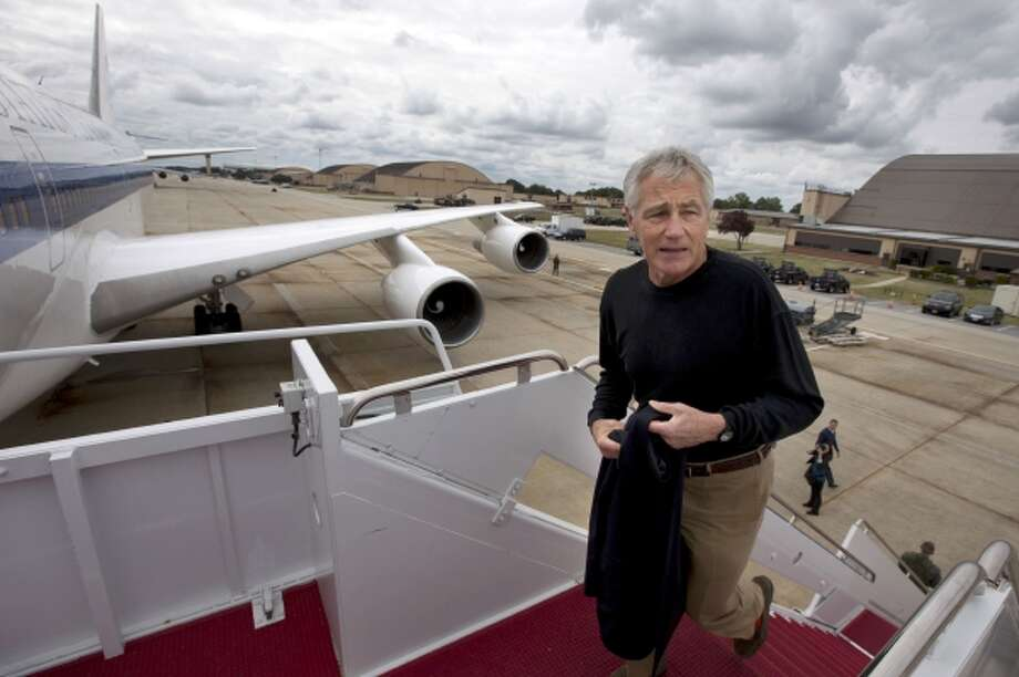 In this Sept. 28, 2013, file photo U.S. Secretary of Defense Chuck Hagel boards his plane at Andrews Air Force Base, Md., en route to South Korea. Saturday, Oct. 5, 2013, the Pentagon ordered most of its approximately 400,000 furloughed civilian employees back to work. Photo: AP / AP2013