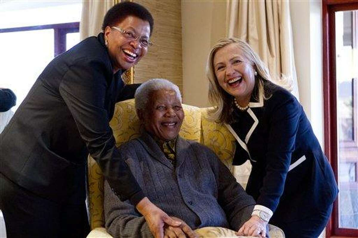 Secretary of State Hillary Rodham Clinton meets with former South Africa President Nelson Mandela, 94, and his wife Graca Machel at his home in Qunu, South Africa, Monday. Associated Press