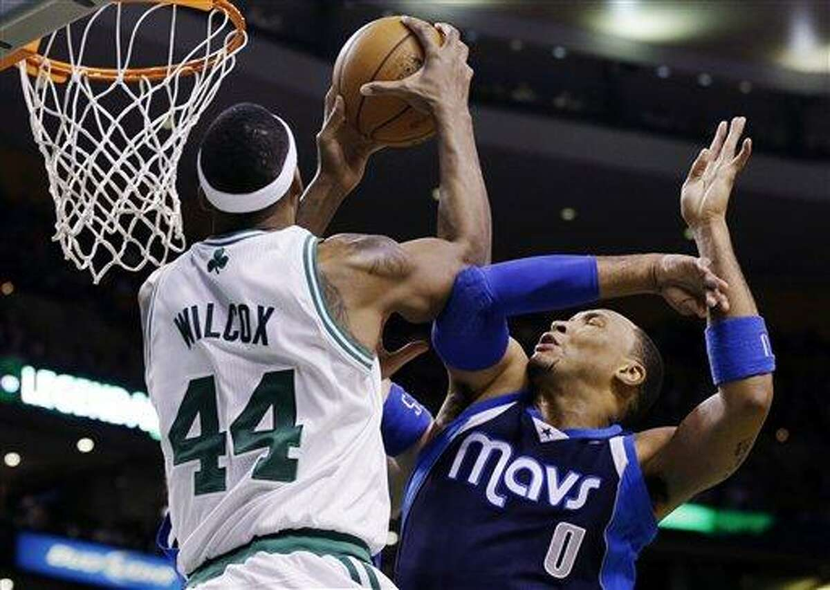 Boston Celtics forward Chris Wilcox (44) goes to the basket against Dallas Mavericks forward Shawn Marion (0) during the first quarter of an NBA basketball game in Boston, Wednesday, Dec. 12, 2012. (AP Photo/Elise Amendola)
