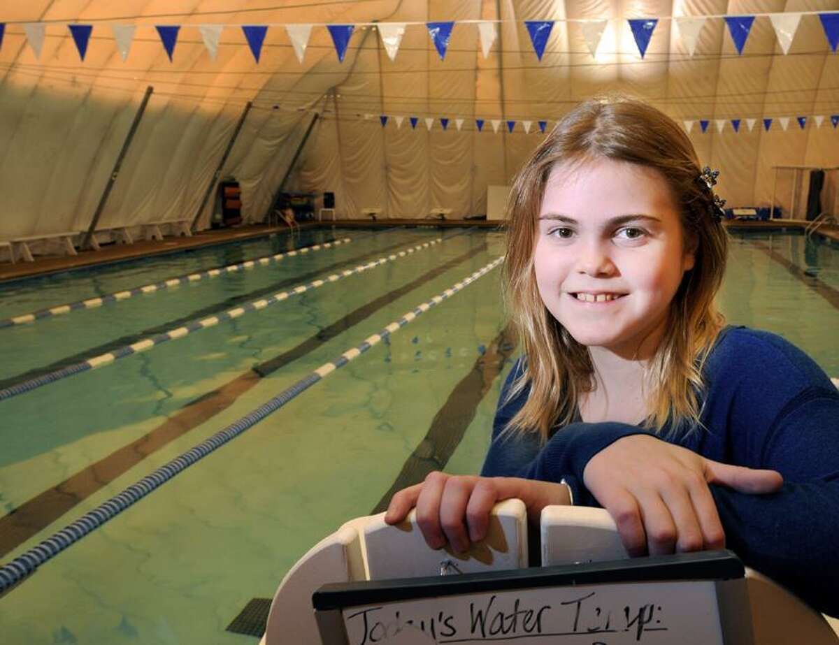 Anna Rogers, 11, has Cystic Fibrosis and is a competitive swimmer, has organized a letter writing campaign with Make-a-Wish Foundation and the Macy's Holiday Wish Letter campaign for other children with life threatening diseases. Photo by Peter Hvizdak / New Haven Register