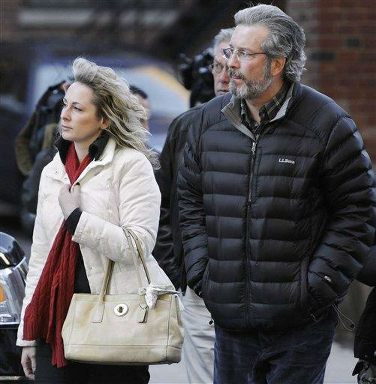 In this December 2011 file photo, Dr. William Petit Jr., right, arrives at Superior Court in New Haven with friend Christine Paluf, on the fourth day of jury deliberations for the penalty phase of the trial of Joshua Komisarjevsky. Associated Press