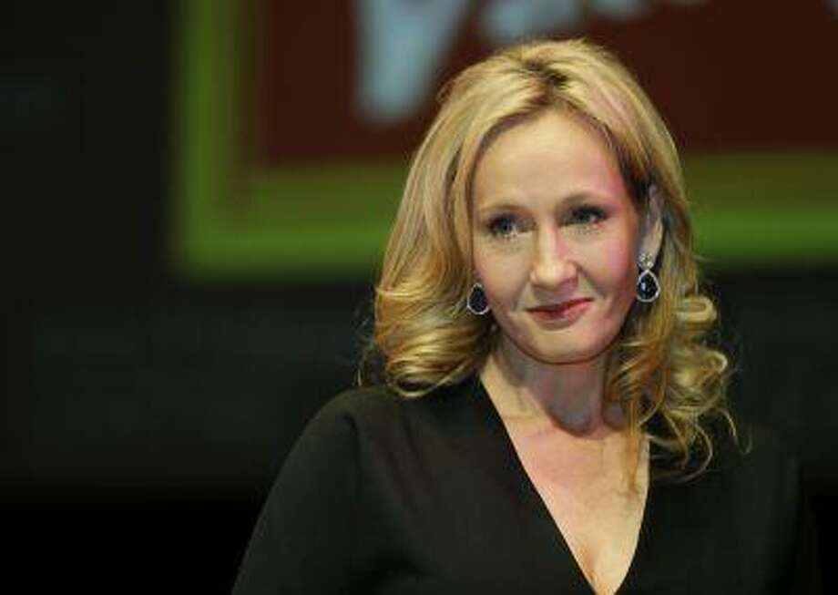 """In this Sept. 27, 2012 photo, British author J.K. Rowling poses for photographers during a photo call to unveil her new book, entitled: """"The Casual Vacancy"""", at the Southbank Centre in London. Not many people read """"The Cuckoo's Calling"""" before word leaked out last weekend that author """"Robert Galbraith"""" was, in fact, J.K. Rowling. But a handful who did managed to get a signed copy. (AP Photo/Lefteris Pitarakis, File) Photo: ASSOCIATED PRESS / THE ASSOCIATED PRESS2013"""