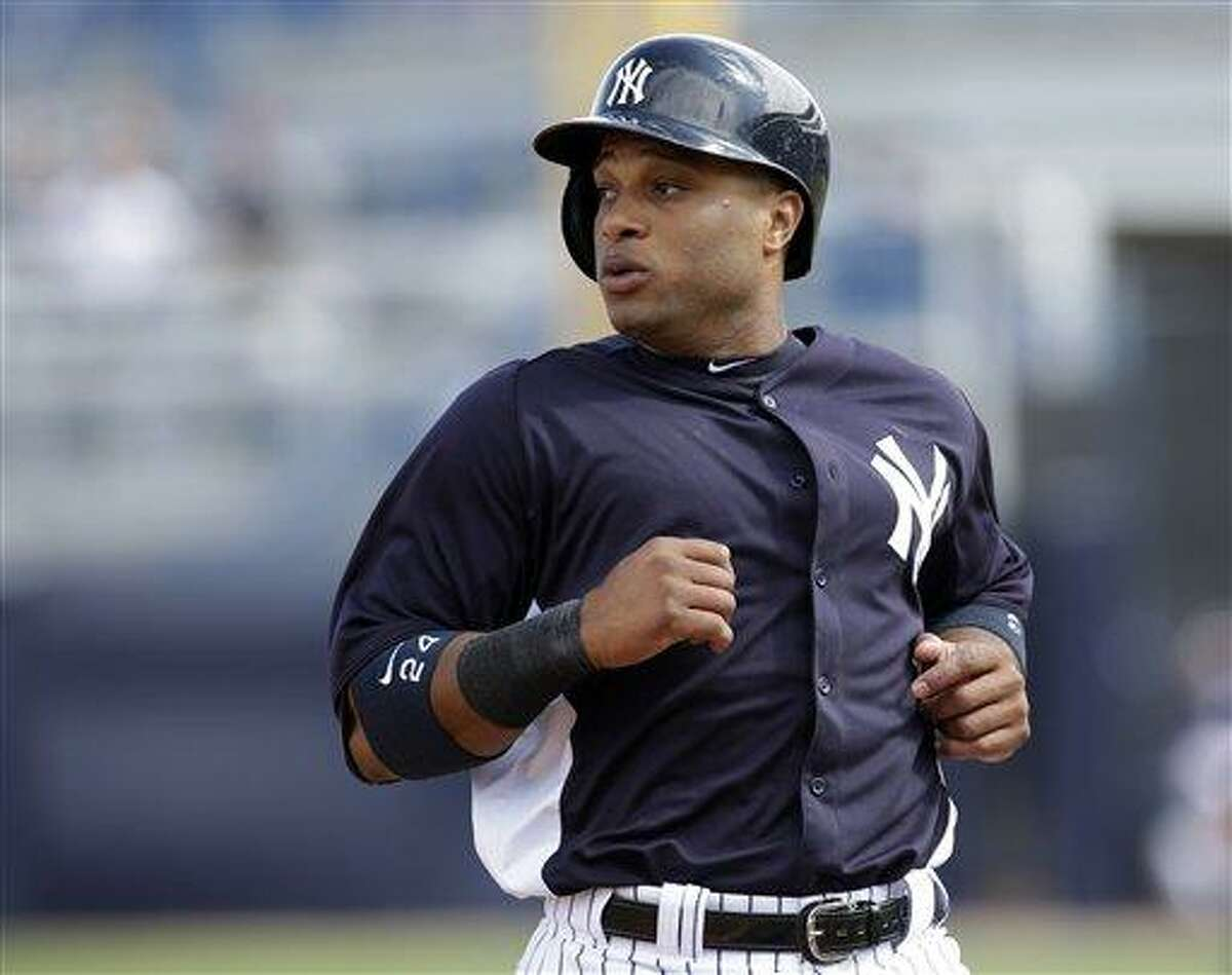 New York Yankees' Robinson Cano runs to third base against the Phialdelphia Phillies during a MLB spring training baseball game Friday, March 1, 2013, in Tampa, Fla. (AP Photo/Chris O'Meara)