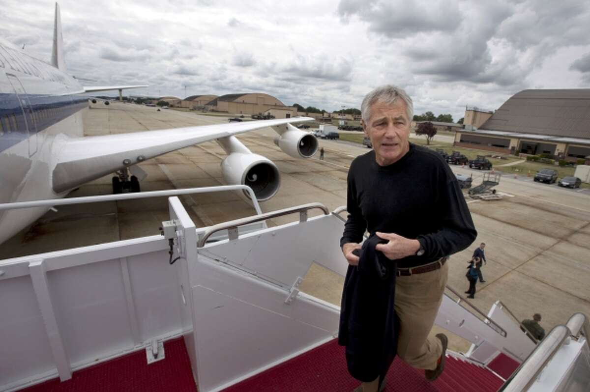 In this Sept. 28, 2013, file photo U.S. Secretary of Defense Chuck Hagel boards his plane at Andrews Air Force Base, Md., en route to South Korea. Saturday, Oct. 5, 2013, the Pentagon ordered most of its approximately 400,000 furloughed civilian employees back to work.