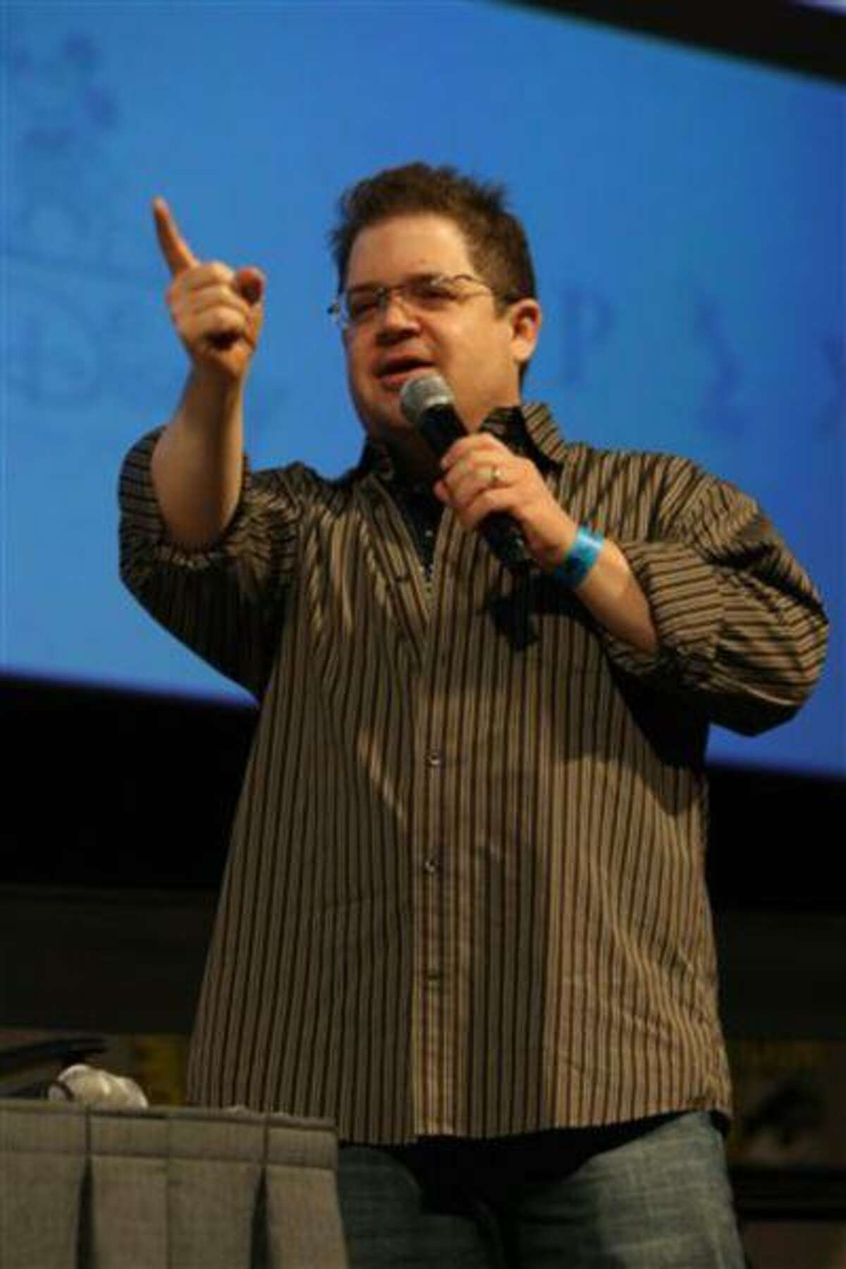 """FILE - This July 24, 2009 file photo shows Patton Oswalt at the Disney Animation Panel at Comic Con at the San Diego Convention Center in San Diego, Calif. Attending Comic-Con is often a once-in-a-lifetime opportunity for many con-goers, but it's just another summertime destination for the likes of """"The Wolverine"""" star Hugh Jackman, geeky funnyman Oswalt and """"The Amazing Spider-Man"""" sequel writers Alex Kurtzman and Roberto Orci. (Photo by Eric Charbonneau/Invision/AP Images, File)"""