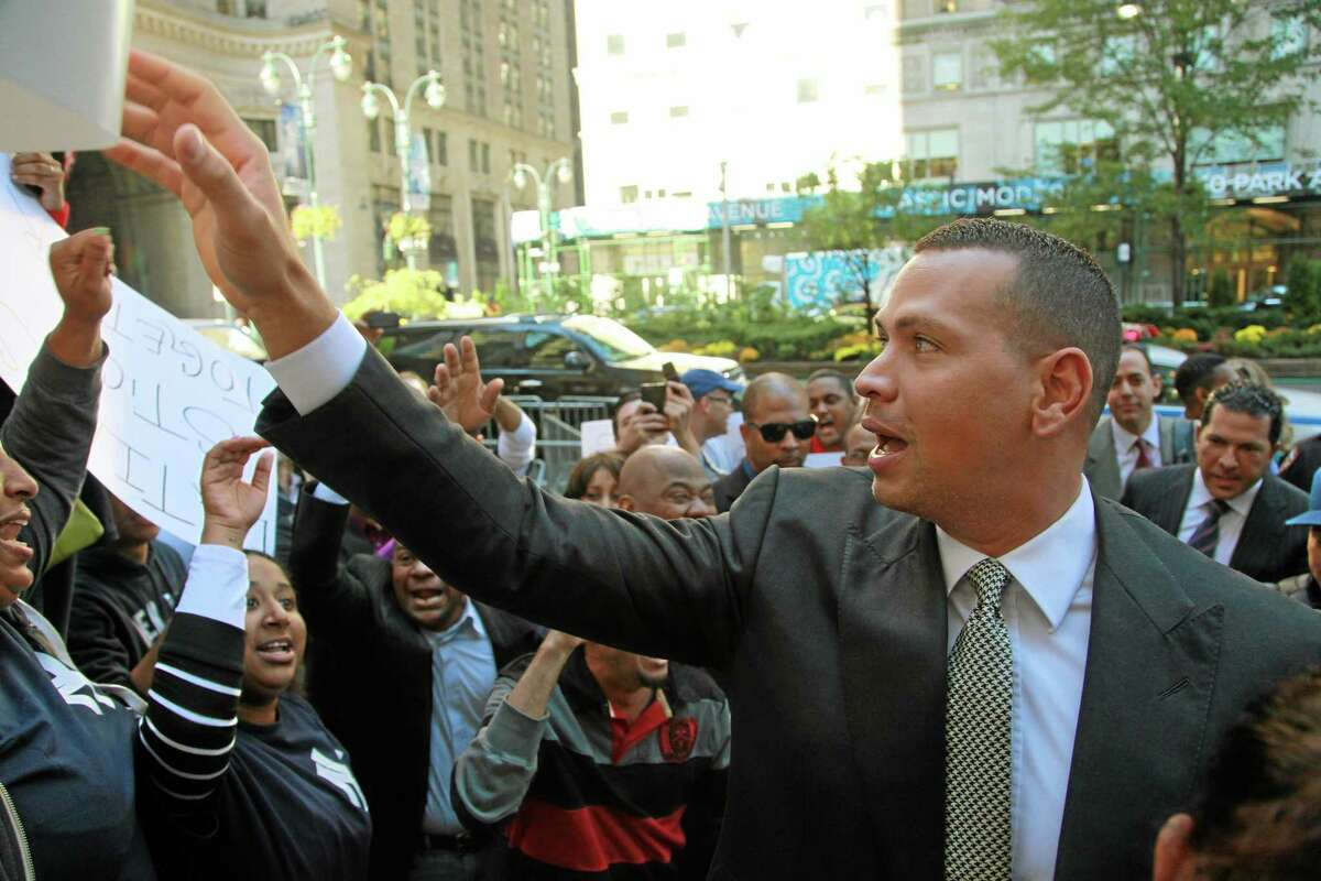 Alex Rodriguez arrives at the offices of Major League Baseball on Tuesday to appeal his 211-game suspension.