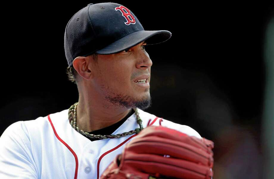 The Red Sox's Felix Doubront steps off the field after pitching against the Toronto Blue Jays at Fenway Park in Boston on Sept. 22. Photo: Steven Senne — The Associated Press  / AP