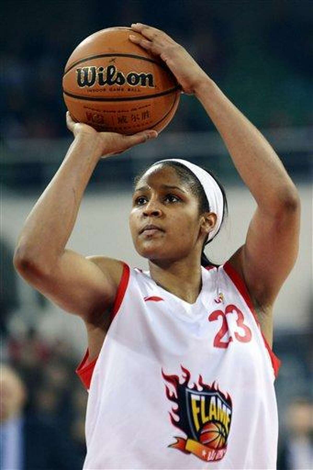 In this Nov. 24, 2012, photo, Shanxi Flame's Maya Moore shoots against the Jiangsu Dragons during a WCBA basketball game in Taiyuan, China. While her Minnesota Lynx team awaits the return of WNBA training camp in May, Moore is averaging 45 points a game and earning mid-six figures for the Flame, helping bring new fans to the women's game in a baseball crazed nation. (AP Photo/CHINATOPIX) CHINA OUT