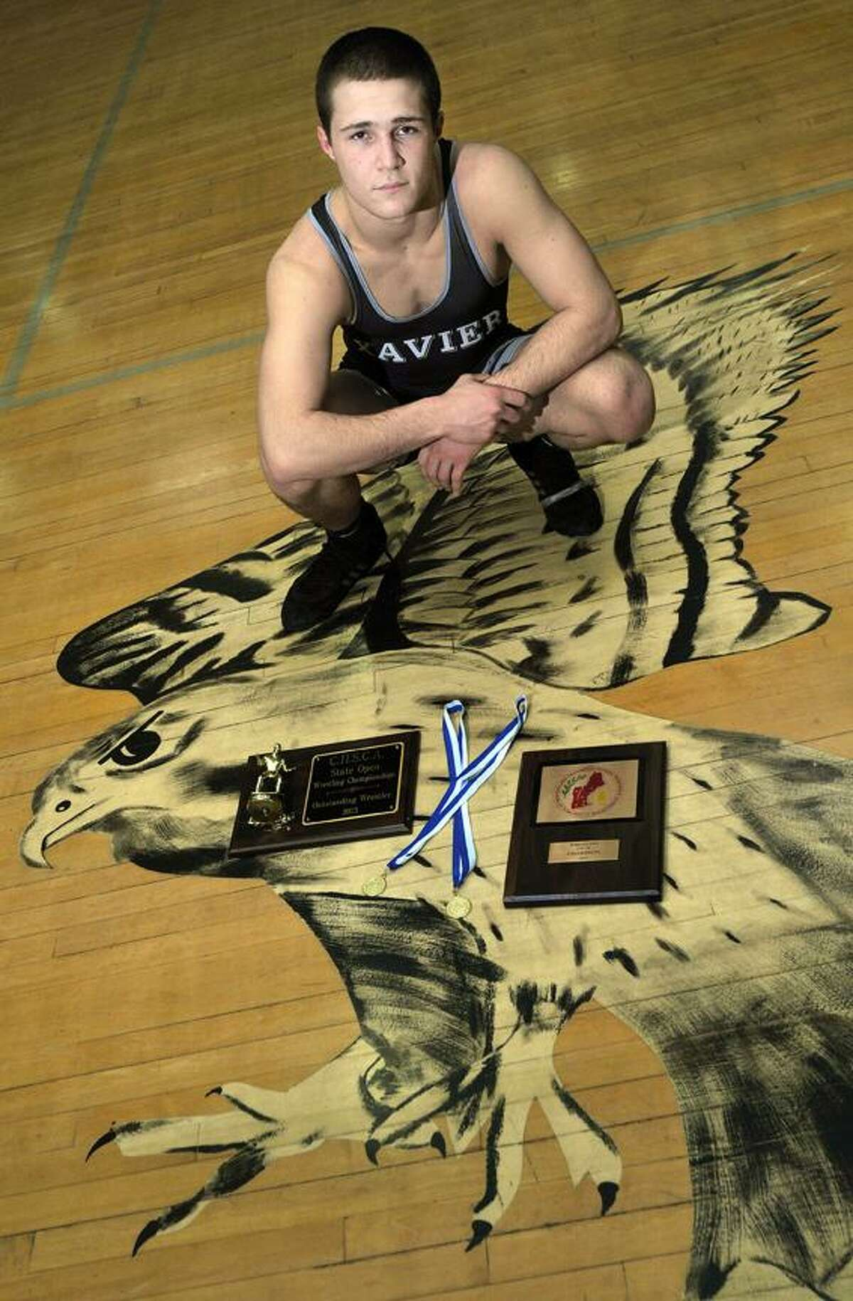 Catherine Avalone/The Middletown Press Xavier senior Elliot Antler won the New England wrestling championship at 170 pounds, earning a 9-1 major decision over Jared Jensen of Brunswick, Maine, in Providence, R.I..