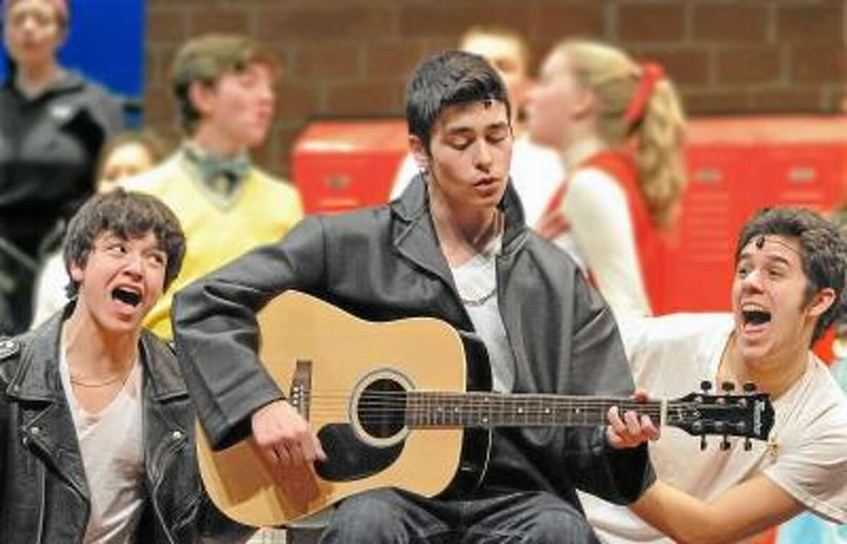 Catherine Avalone/The Middletown Press Ian Pekar as Danny Zuko, center, Justin Keib as Doody,at left and Nick Maturo as Roger, at right perform dress rehearsal Tuesday night in the Mercy and Xavier High School's production of Grease. The shows are this weekend, Friday and Saturday at 7:30 p.m. and Sunday at 2 p.m. at the Mercy High School auditorium. Tickets are $10.