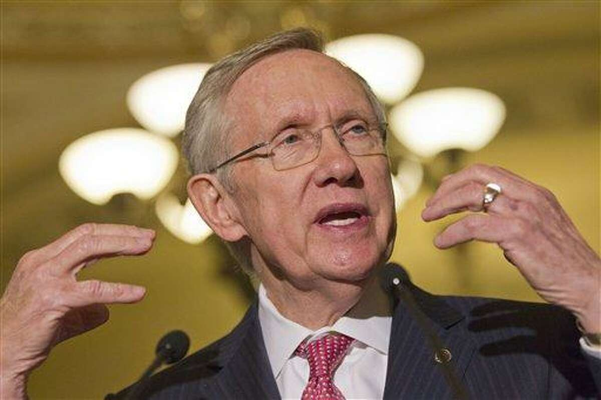 Senate majority leader Harry Reid gestures as he speaks to the media as lawmakers moved toward resolving their feud over filibusters of White House appointees on Capitol Hill in Washington, Tuesday, July 16, 2013. (AP Photo/Jacquelyn Martin)