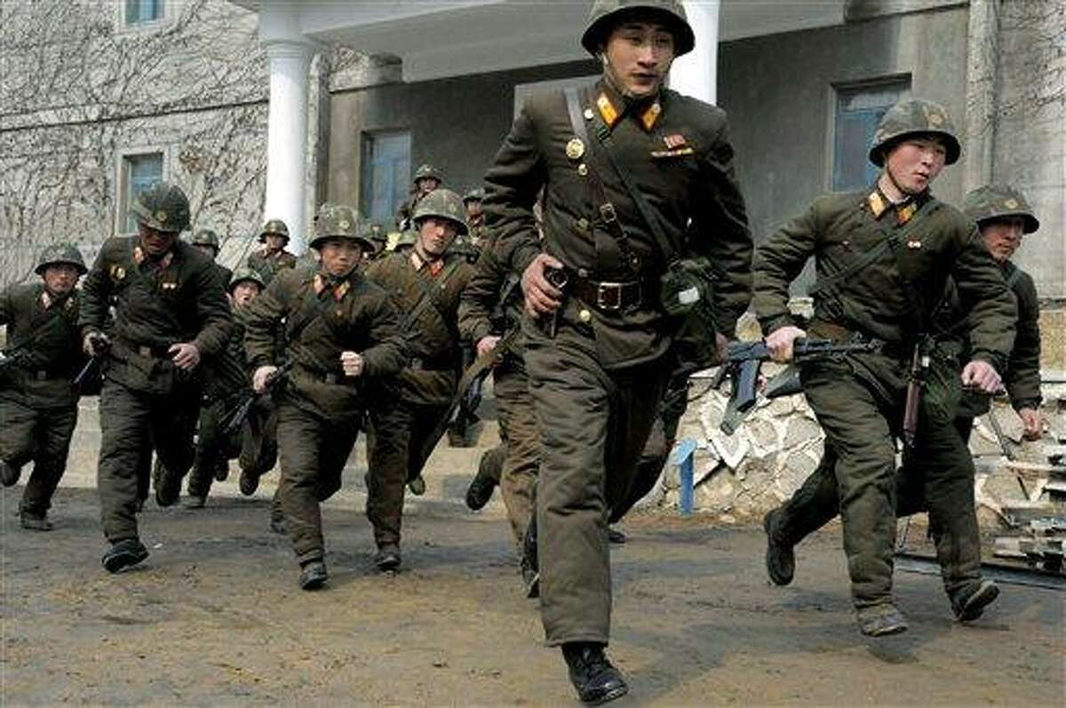 Soldiers of Kim Il Sung Military University perform military training on Wednesday, March 6, 2013, in Pyongyang, North Korea. North Korea's military is vowing to cancel the 1953 cease-fire that ended the Korean War, straining already frayed ties between Washington and Pyongyang as the United Nations moves to impose punishing sanctions over the North's recent nuclear test. (AP Photo/Kim Kwang Hyon)