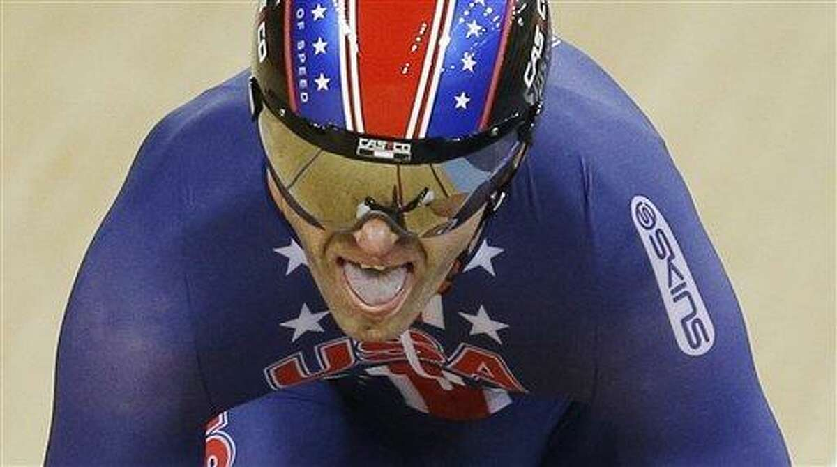 Jimmy Watkins, of the United States, competes during a track cycling men's sprint event, during the 2012 Summer Olympics, Saturday, Aug. 4, 2012, in London. No wonder Watkins is a fast sprinter. He's used to running up slopes with a hose to extinguish fires. The powerfully built Watkins, a 29-year-old firefighter from Bakersfield, Calif., can already be proud of his achievements at the Olympic Velodrome. On Sunday, Aug. 5, 2012, he will compete in the quarterfinals of the sprint tournament, track cycling's blue-ribbon event. (AP Photo/Matt Rourke)