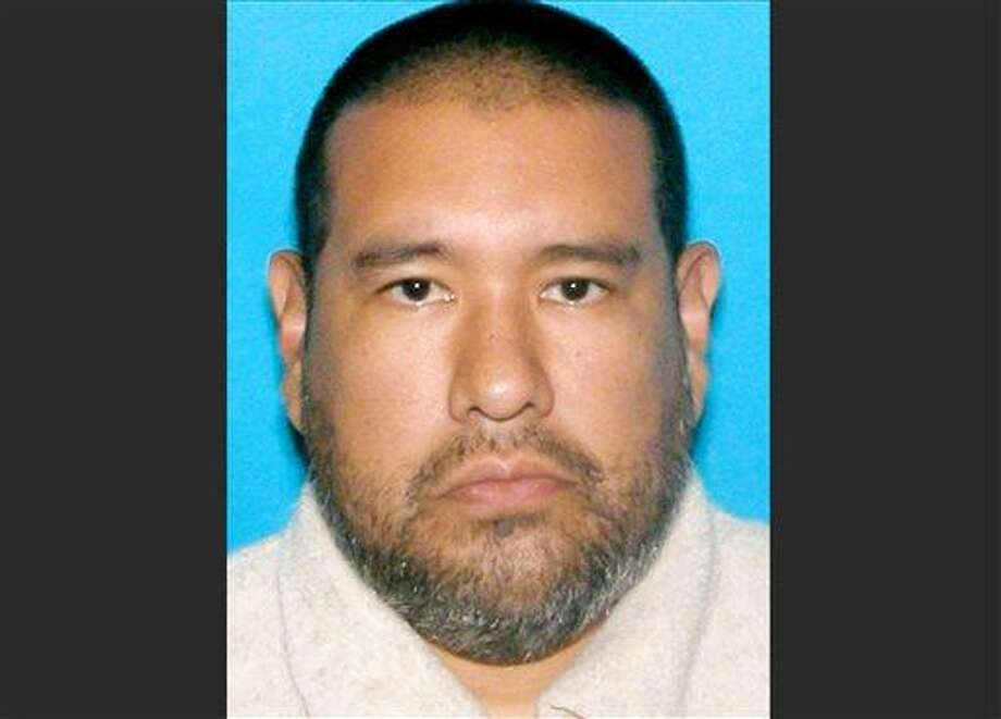 This photo provided by the Omaha Police Department shows Dr. Anthony Garcia, 40. The Indiana doctor who was fired from a Nebraska medical school more than a decade ago has been arrested on suspicion of killing four people with ties to the school in two separate attacks five years apart. Garcia, who lives in Terre Haute, Ind., was arrested by Illinois State Police on Monday, July 15, 2013 during a traffic stop in Union County, in southern Illinois. (AP Photo/Omaha Police Department) Photo: AP / Omaha Police Department
