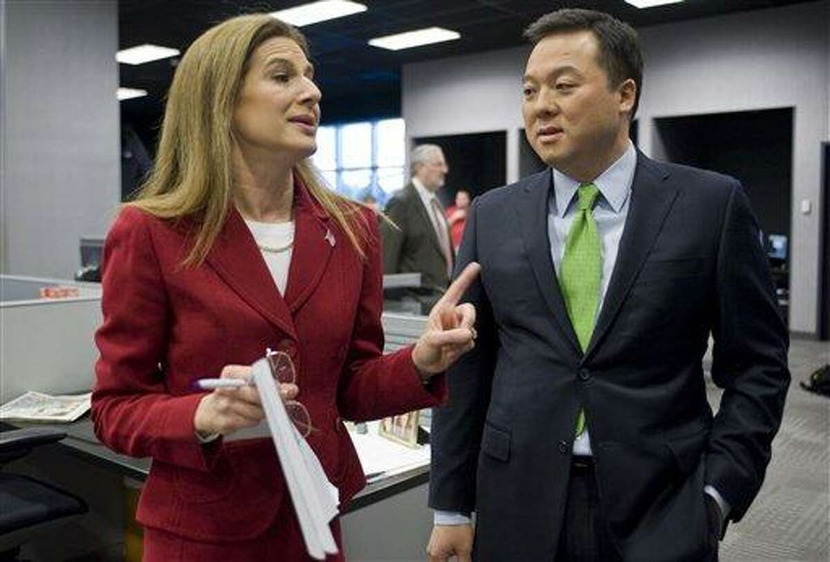AP FILE PHOTO: Democratic candidates for U.S. Senate, state Rep. William Tong, left, and former Secretary of the State Susan Bysiewicz, talk before a live televised debate in West Hartford, Conn., Thursday, April 5, 2012. Five Democrats are vying for the party's endorsement in Connecticut's U.S. Senate race to ultimately fill the seat being vacated by the retiring Sen. Joe Lieberman, an independent. (AP Photo/Jessica Hill)