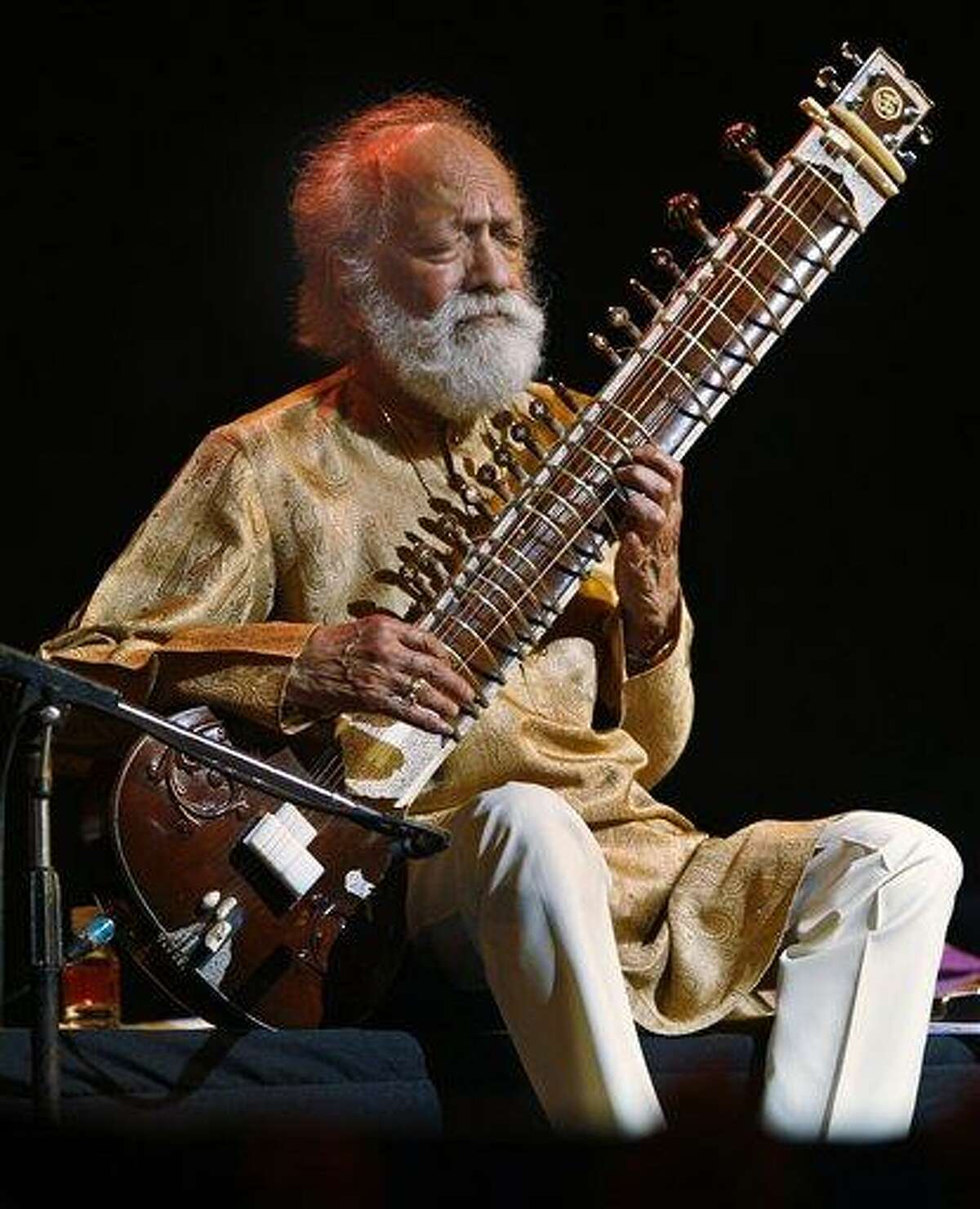 FILE - In this Feb. 7, 2012 file photo, Indian musician and sitar maestro Pandit Ravi Shankar, 92, performs during a concert in Bangalore, India. Shankar, the sitar virtuoso who became a hippie musical icon of the 1960s after hobnobbing with the Beatles and who introduced traditional Indian ragas to Western audiences over an eight-decade career, died Tuesday, Dec. 11, 2012. He was 92. (AP Photo/Aijaz Rahi, File)