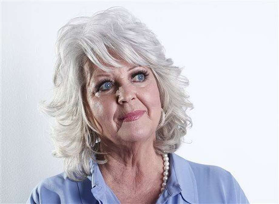 FILE - In this Jan. 17, 2012 file photo, celebrity chef Paula Deen poses for a portrait in New York. Deen has replaced her lead legal team, the latest fallout from her admission she used racial slurs in the past. Deen announced last week she had cut ties with her longtime agent who helped make her a Food Network star and start a media and merchandising empire that has largely collapsed. Grace Speights, an attorney for Morgan, Lewis & Bockius, has been retained as the new lead counsel for Paula Deen Enterprises Inc. and other defendants in an employment discrimination lawsuit, according to Jennifer Costa, a spokeswoman for the Washington-based firm.  (AP Photo/Carlo Allegri, File) Photo: AP / R-Allegri