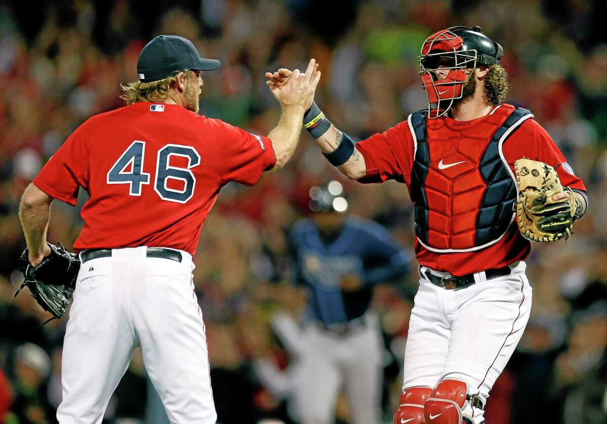 Red Sox pitcher Ryan Dempster (46) and catcher Jarrod Saltalamacchia celebrate a 12-2 win over the Tampa Bay Rays in Game 1 of the American League division series Friday in Boston.