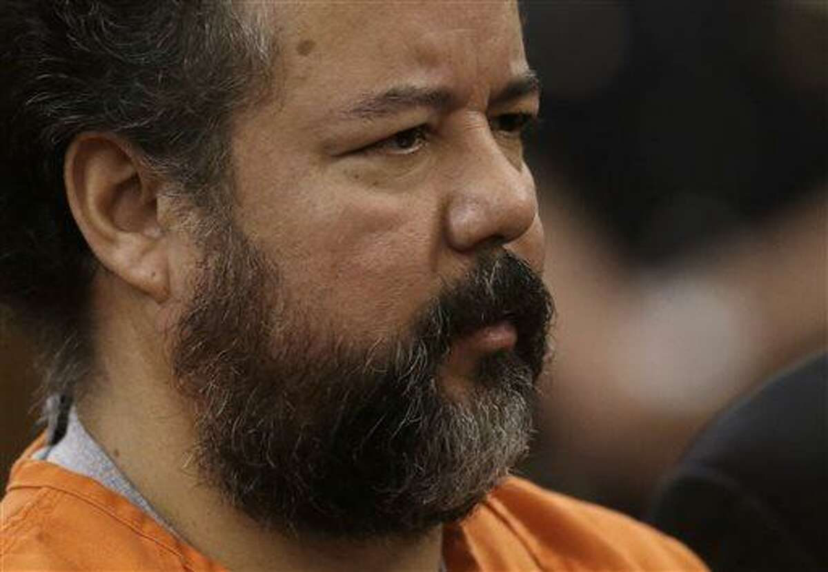 Ariel Castro stands before a judge during his arraignment on an expanded 977-count indictment Wednesday, July 17, 2013, in Cleveland. Castro is charged with kidnapping and raping three women over a decade in his Cleveland home. (AP Photo/Tony Dejak)