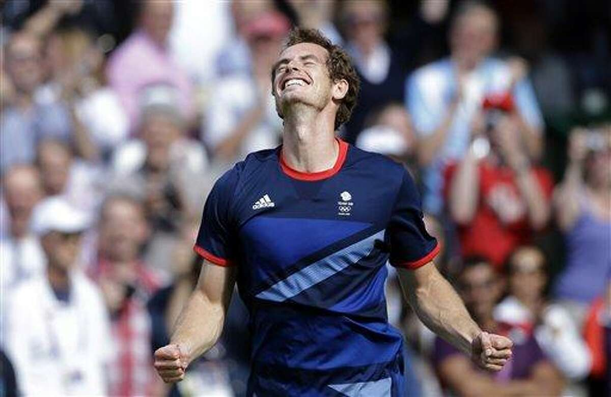 Britain's Andy Murray celebrates after defeating Switzerland's Roger Federer to win the men's singles gold medal match Sunday at the All England Lawn Tennis Club at Wimbledon, in London, at the 2012 Summer Olympics. Associated Press