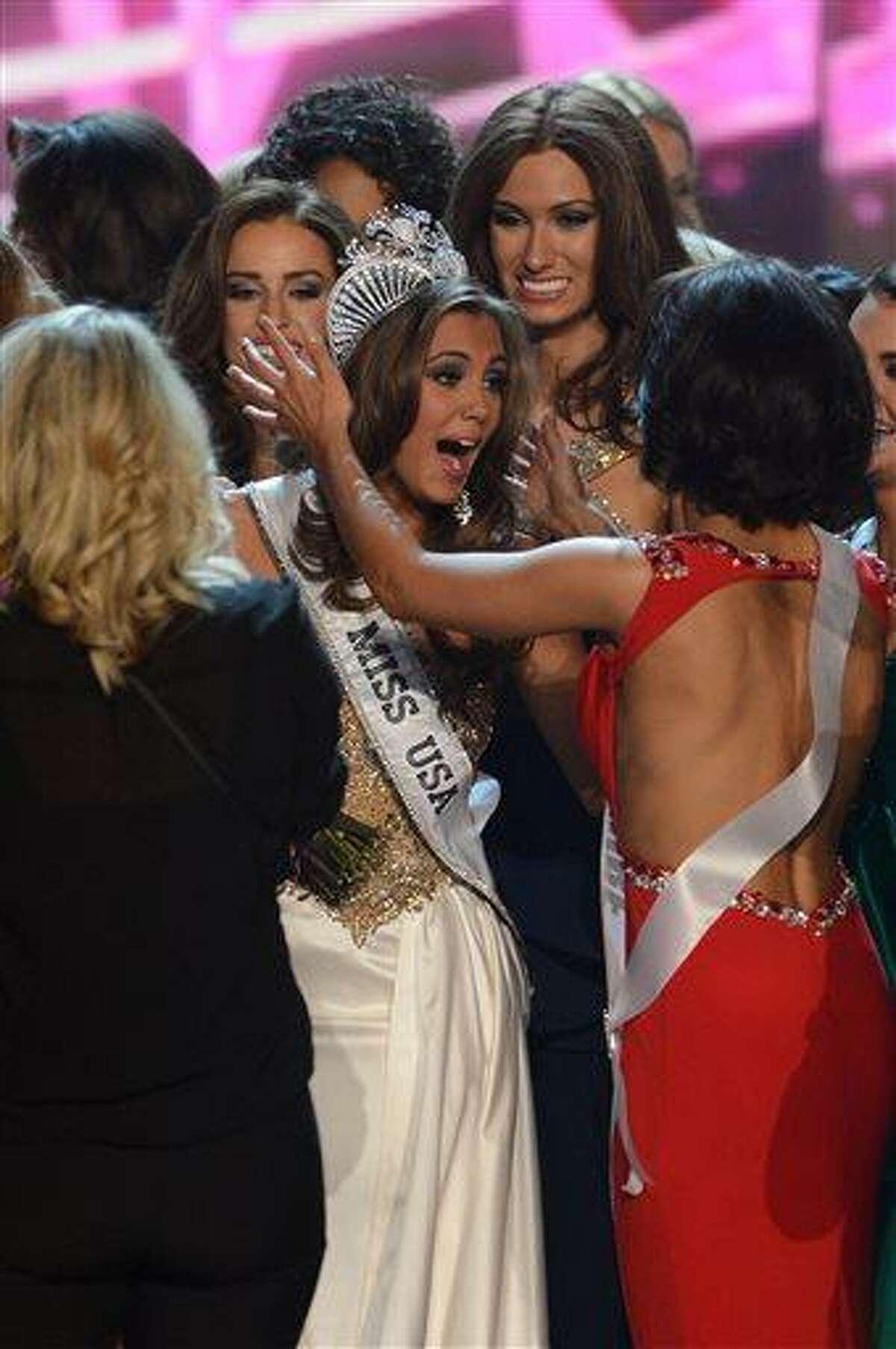 Miss Connecticut Erin Brady, center, reacts after winning the Miss USA 2013 pageant, Sunday, June 16, 2013, in Las Vegas. (AP Photo/Jeff Bottari)