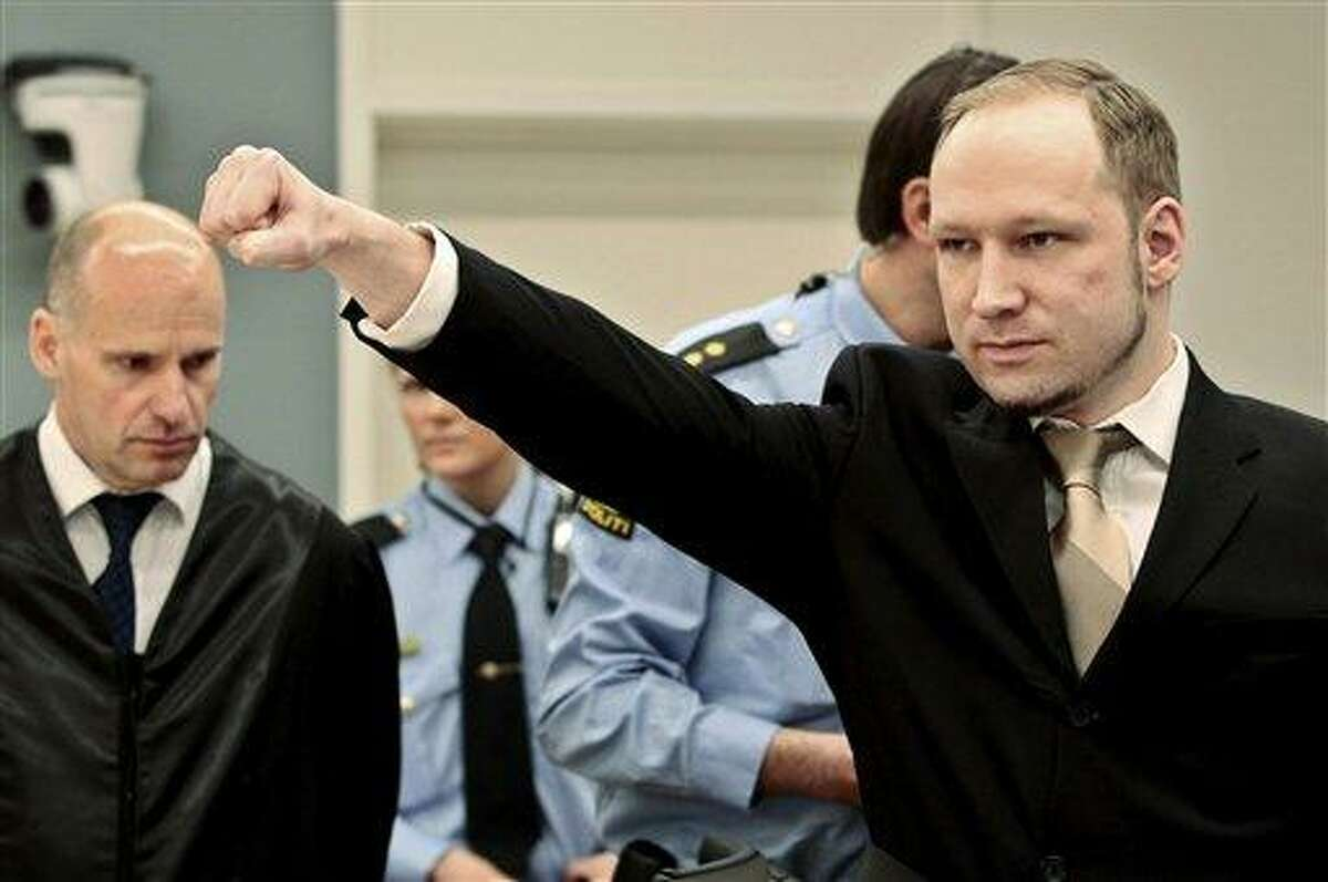 Accused Norwegian Anders Behring Breivik gestures as he arrives at the courtroom Monday in Oslo, Norway. The terror trial against an anti-Muslim fanatic who confessed to killing 77 people in Norway starts amid worries that he will use the proceedings to showcase his radical views. After opening statements, Anders Behring Breivik is set to testify for five days, explaining why he set off a bomb in downtown Oslo, killing eight, and then shot to death 69 people, mostly teenagers, at a Labor Party youth camp on Utoya island, outside the Norwegian capital. Associated Press