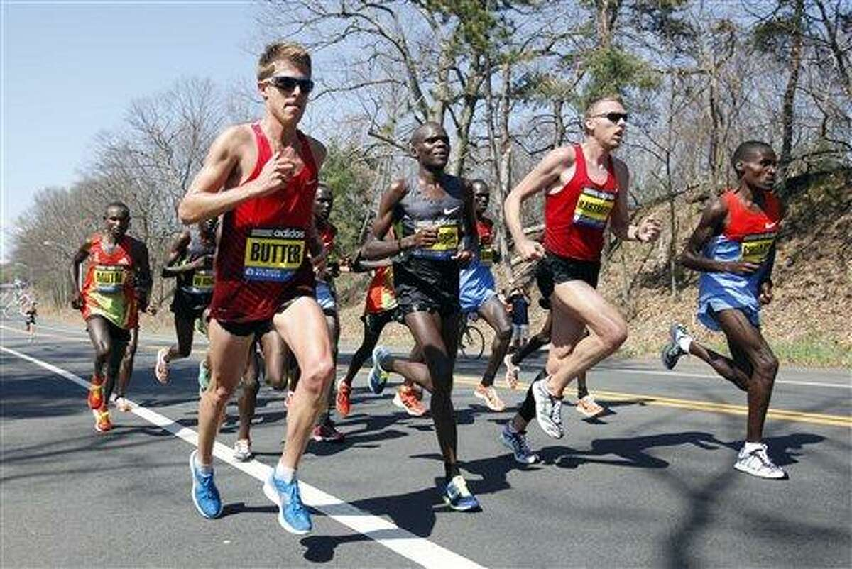 The elite men runners including Geoffrey Mutai, of Kenya, left, Michel Butter, of the Netherlands, second from left, Josphat Ndambiri, of Kenya, third from right, Jason Hartmann, of Boulder, Col., second from right, and Dickson Chumba, of Kenya, right, compete in the Boston Marathon in Wellesley, Mass., Monday, April 16, 2012. (AP Photo/Michael Dwyer