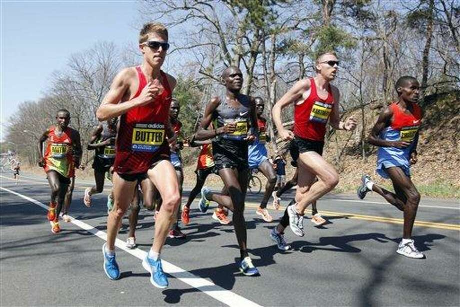 The elite men runners including Geoffrey Mutai, of Kenya, left, Michel Butter, of the Netherlands, second from left, Josphat Ndambiri, of Kenya, third from right, Jason Hartmann, of Boulder, Col., second from right, and Dickson Chumba, of Kenya, right, compete in the Boston Marathon in Wellesley, Mass., Monday, April 16, 2012. (AP Photo/Michael Dwyer Photo: AP / AP
