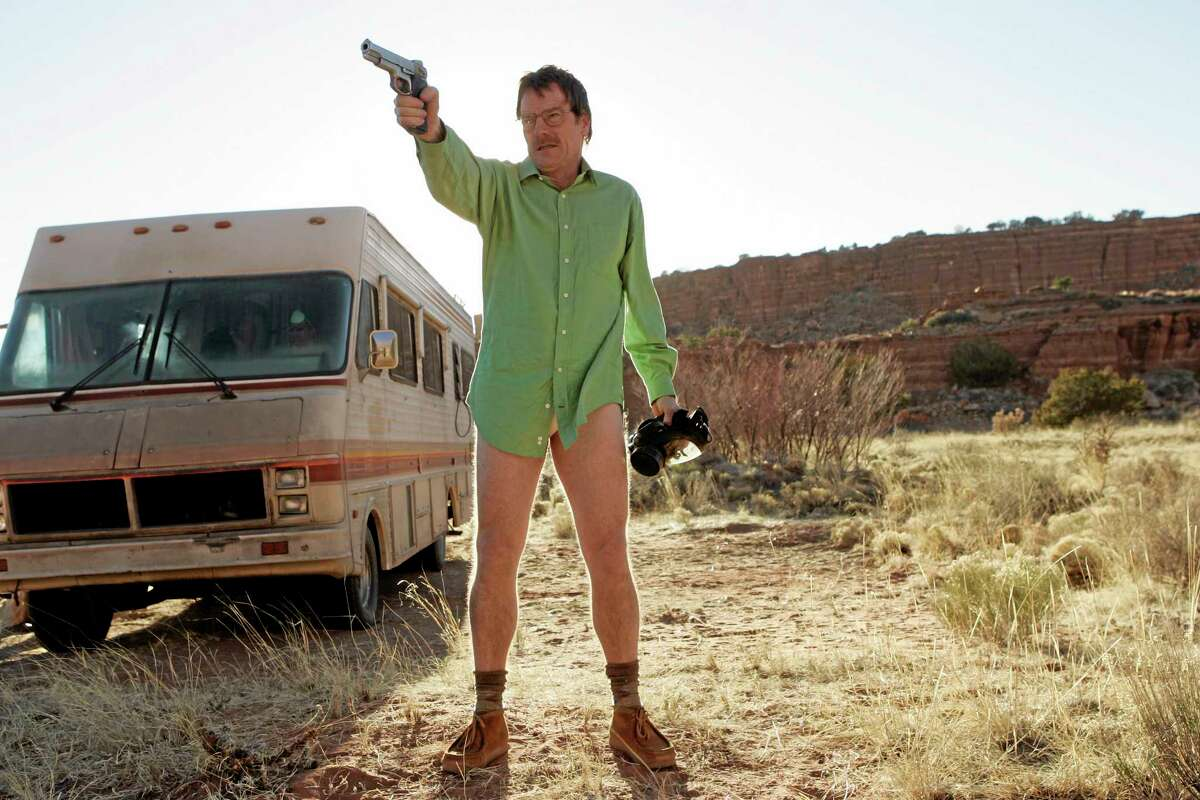 """This image released by AMC shows Walter White, played by Bryan Cranston, next to the Winnebago he uses as a mobile meth lab in the pilot episode of """"Breaking Bad."""" The series finale of the popular drama series aired on Sunday, Sept. 29. (AP Photo/AMC, Doug Hyun)"""