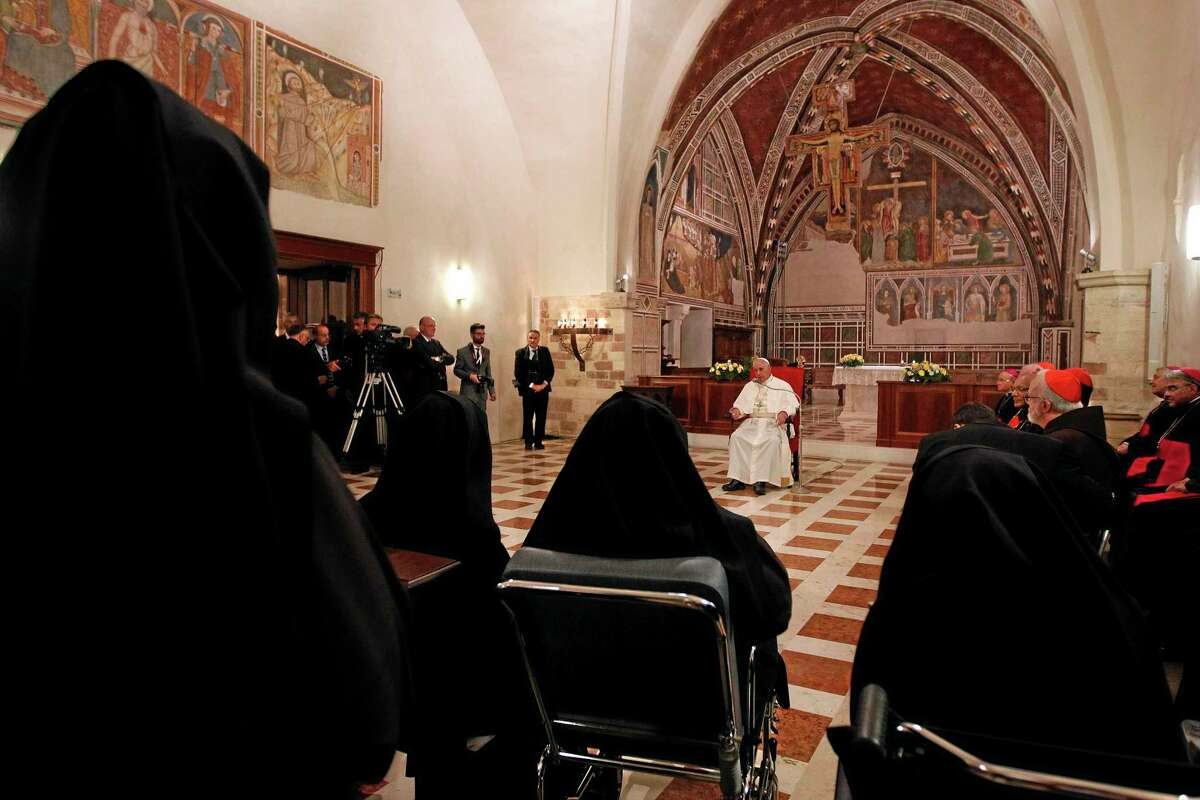 Pope Francis speaks during a meeting with cloistered nuns at the St. Chiara Basilica in Assisi, Friday, Oct. 4, 2013. Pope Francis broke bread with the poor and embraced the disabled on a pilgrimage to his namesake's hometown Friday, urging the faithful to follow the example of the 13th-century St. Francis, who renounced a wealthy, dissolute lifestyle to embrace a life of poverty and service to the poor. Pope Francis broke bread with the poor and embraced the disabled on a pilgrimage to his namesake's hometown Friday, urging the faithful to follow the example of the 13th-century St. Francis, who renounced a wealthy, dissolute lifestyle to embrace a life of poverty and service to the poor. (AP Photo/Giampiero Sposito, Pool)