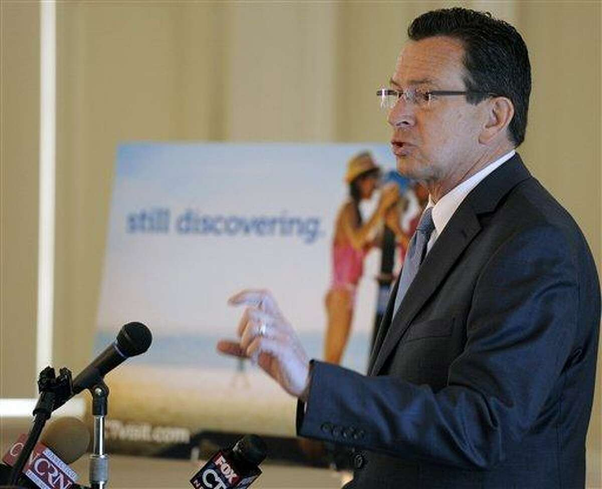 """Connecticut Gov. Dannel P. Malloy speaks during an unveiling of a tourism branding campaign at the Old State House in Hartford, Conn., Monday, May 14, 2012. Connecticut is using a new marketing strategy to boost tourism that draws attention to the state's role in the Revolutionary War. Gov. Dannel P. Malloy unveiled on Monday a """"Still Revolutionary"""" Connecticut brand, part of a two-year, $27 million state marketing initiative. AP Photo/Sean D. Elliot"""