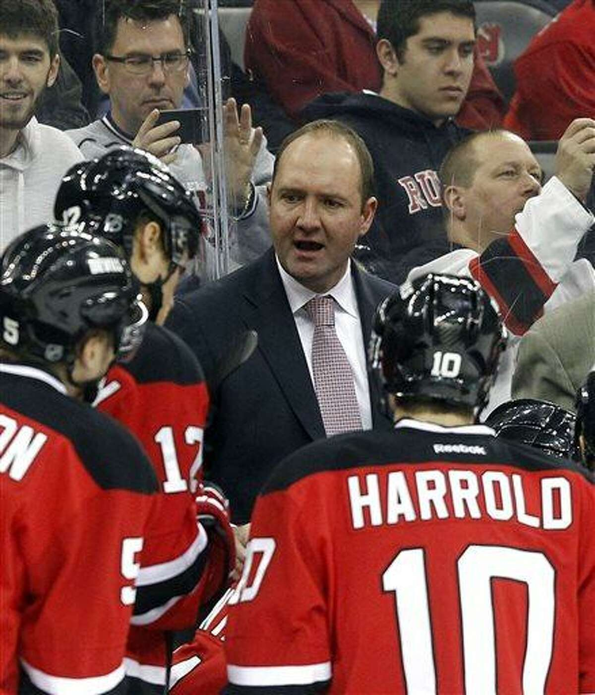 FILE - In this April 20, 2013 file photo, New Jersey Devils head coach Peter DeBoer talks to his team during the first period of an NHL hockey game against the Florida Panthers in Newark, N.J. While caught off guard by star forward Ilya Kovalchuk's decision to retire from the NHL and return home to Russia, New Jersey Devils coach DeBoer said his team's job next season is to play well enough to make up for the loss of one of the NHL's top players. (AP Photo/Jason DeCrow, File)