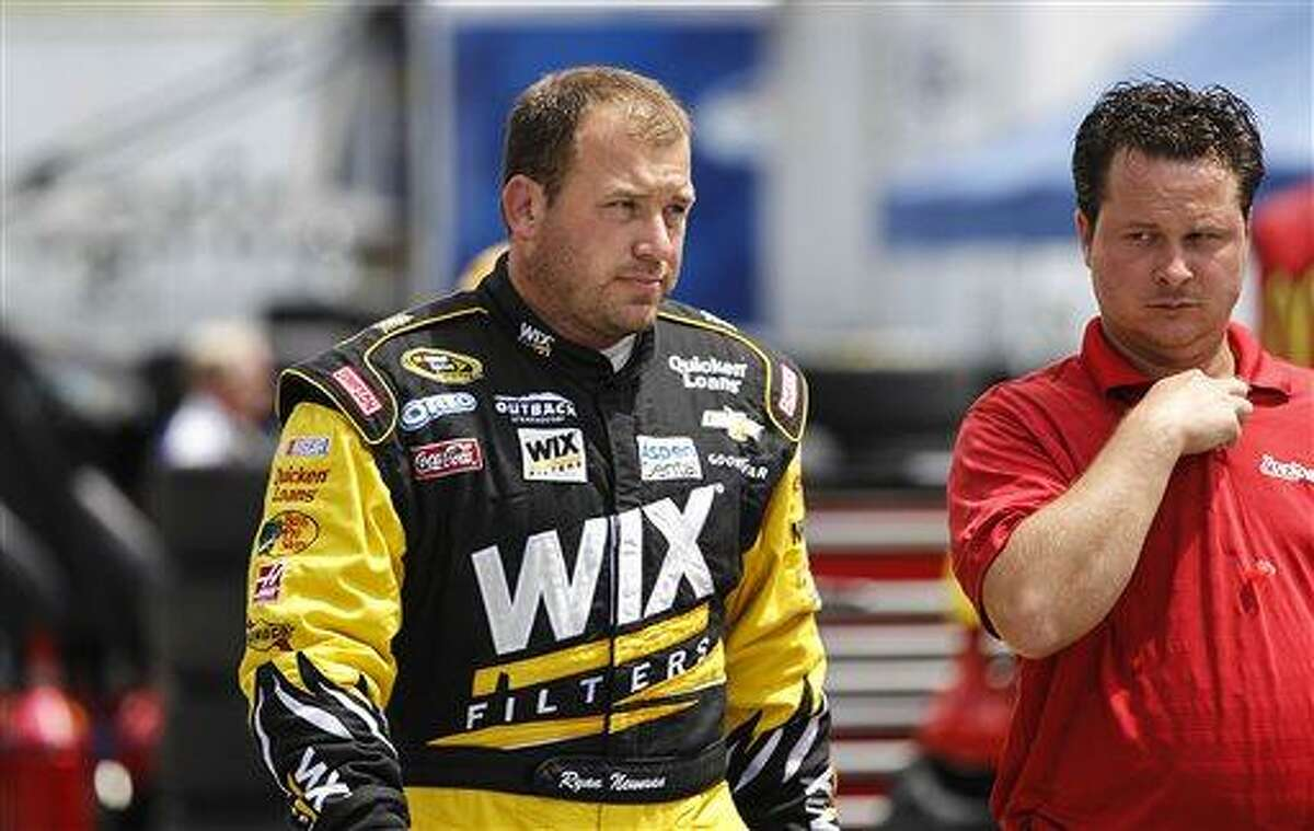 NASCAR driver Ryan Newman, left, heads out after practice for the NASCAR New Hampshire 300 Sprint Cup Series Camping World RV Sales 301 auto race at the New Hampshire Motor Speedway in Loudon, N.H., Friday, July 12, 2013, (AP Photo/Cheryl Senter)