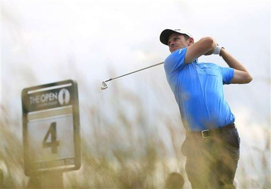 Justin Rose of England plays a shot off the 4th tee during a practice round ahead of the British Open Golf Championship at Muirfield, Scotland, Tuesday July 16, 2013. (AP Photo/Peter Morrison) Photo: AP / AP