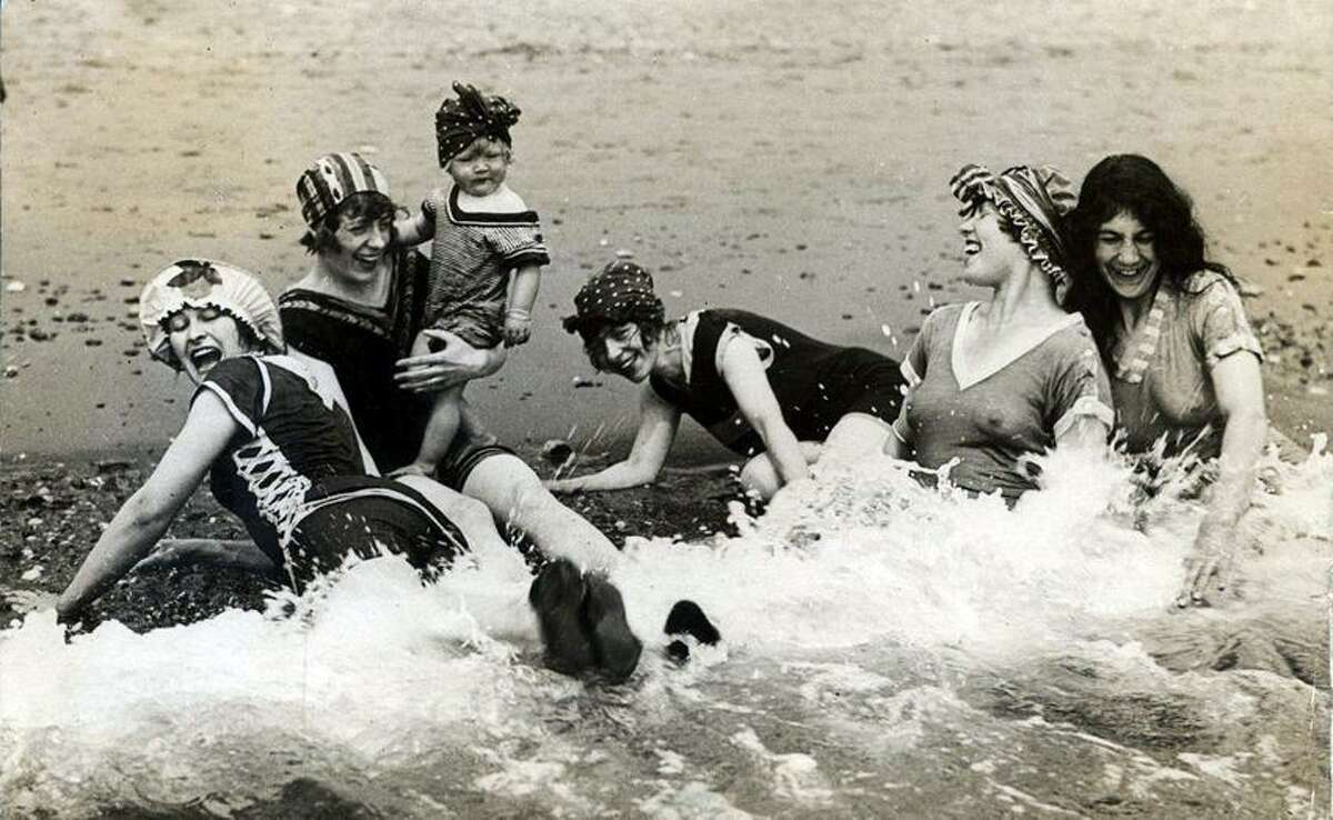 Women having fun in the sea. Location and date unknown.