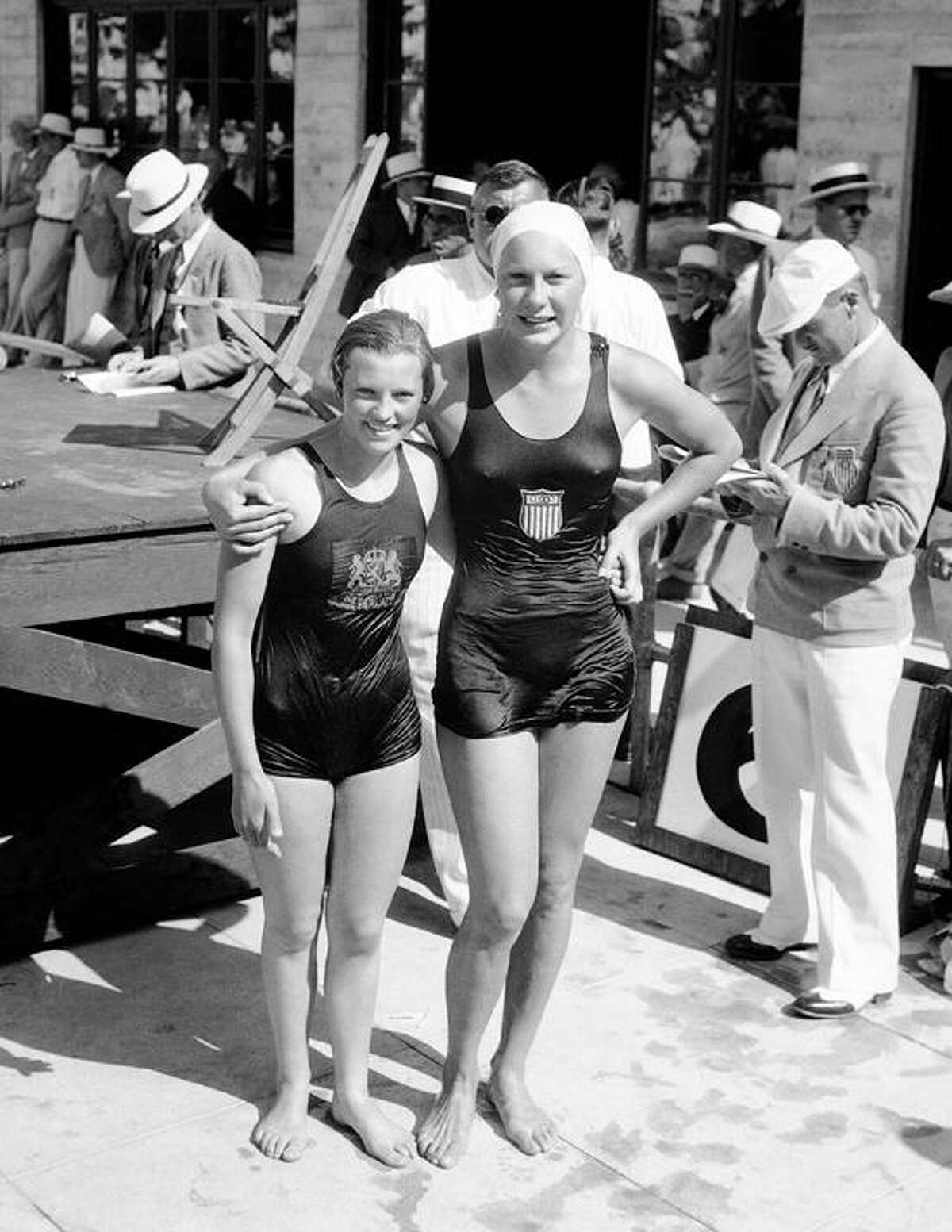 Helene Madison, right, and Willy Den Guden, Holland, photographed at the Olympic swimming stadium in Los Angeles, August 8, 1932 when they were first and second, respectively, in the finals of the 100-meter free style swim. Miss Madison set a new world's record, surpassing a new one which Miss Den Guden had set during the semi-finals. (AP Photo)