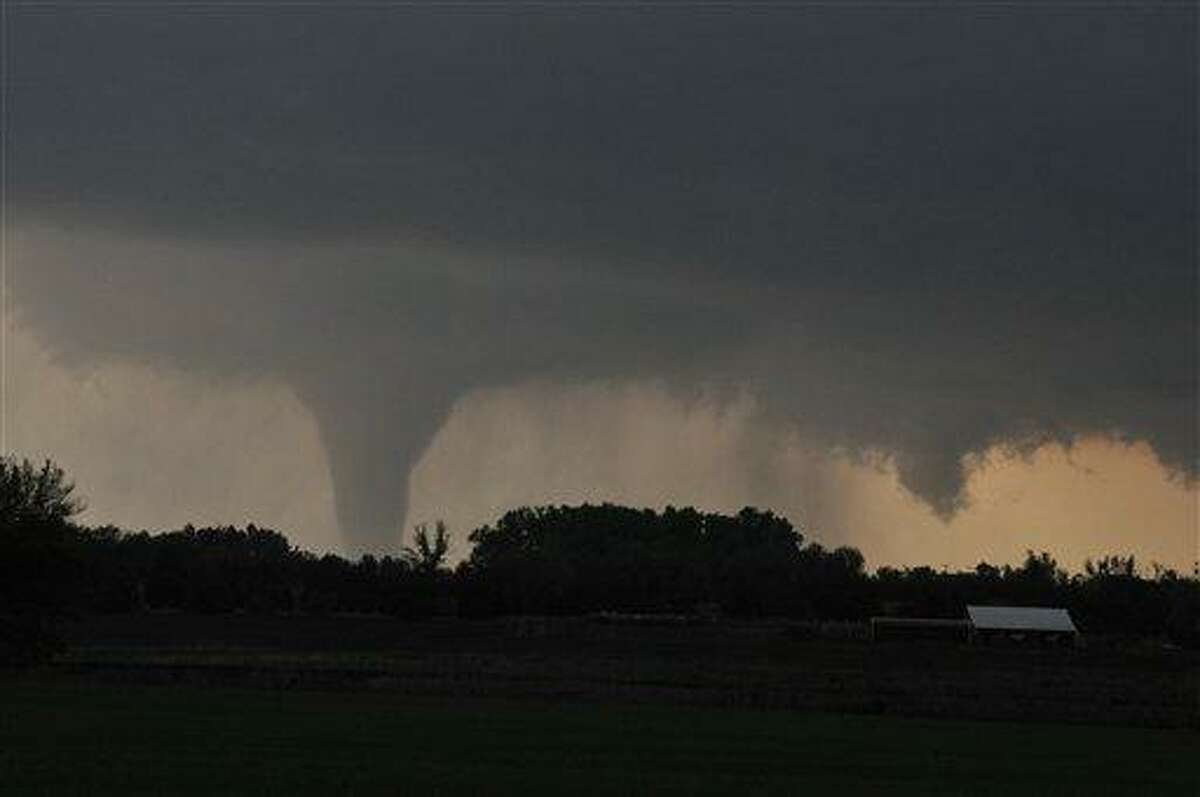 A tornado moves on the ground north of Solomon, Kan., Saturday evening with I-70 seen in the foreground. Associated Press