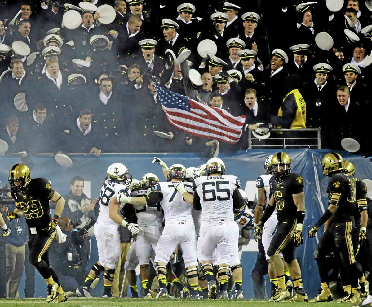 In this Dec. 8, 2012, file photo, Navy players celebrate after a touchdown during the second half of a game against Army in Philadelphia.