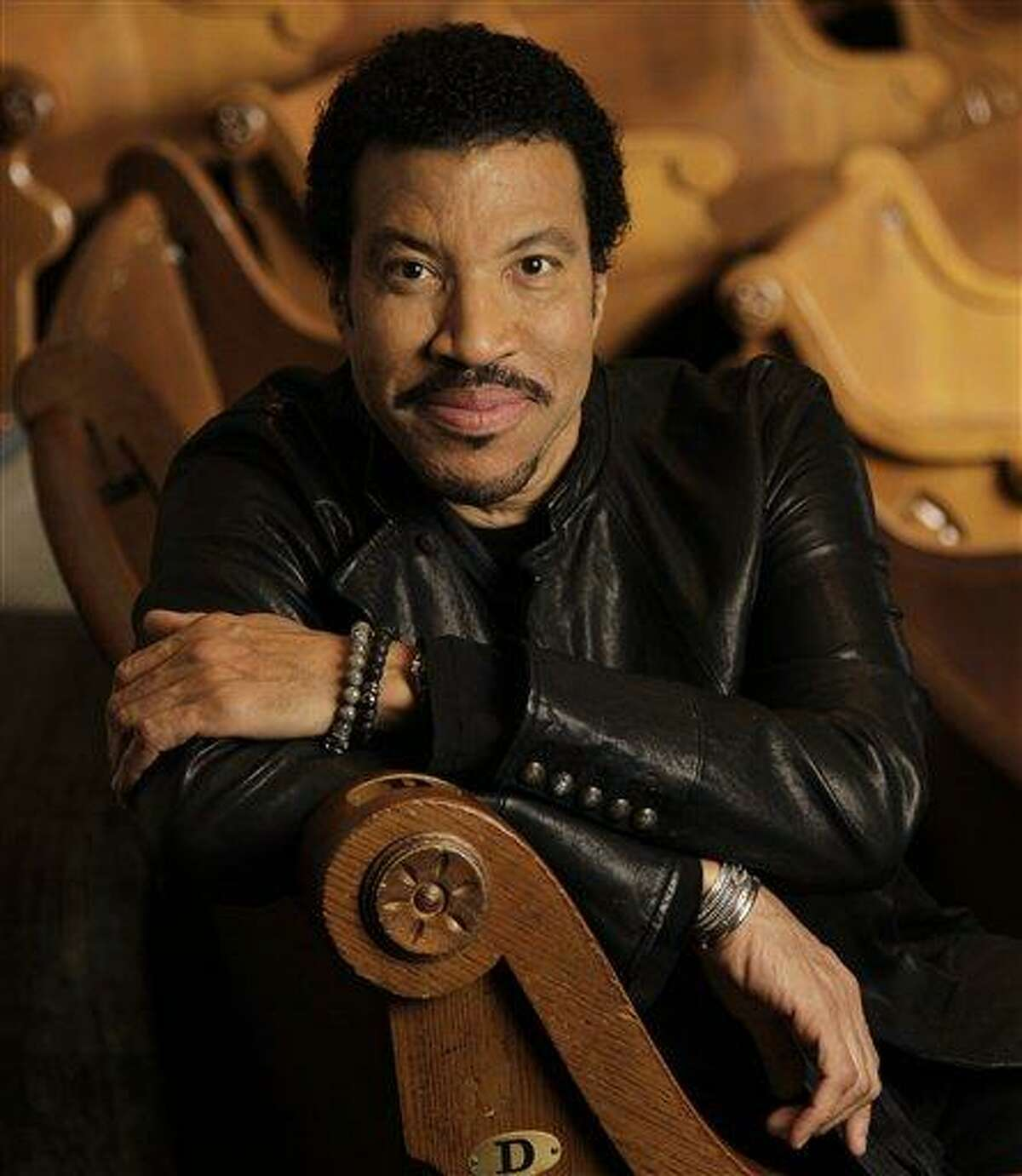 """This Jan. 11, 2012 photo shows Lionel Richie in Nashville, Tenn. Richie and Pamela Anderson owe the government money. California tax authorities have put Anderson on the latest list of the state's biggest income-tax delinquents. The Franchise Tax Board said the former """"Baywatch"""" star owes $524,241 in state income taxes. Meanwhile, E! Online reports that Richie, a music legend, owes the federal government $1.1 million in unpaid taxes and that a lien has been issued warning that the singers' assets may be seized if he doesn't pay up in a timely manner. (AP Photo/Mark Humphrey)"""