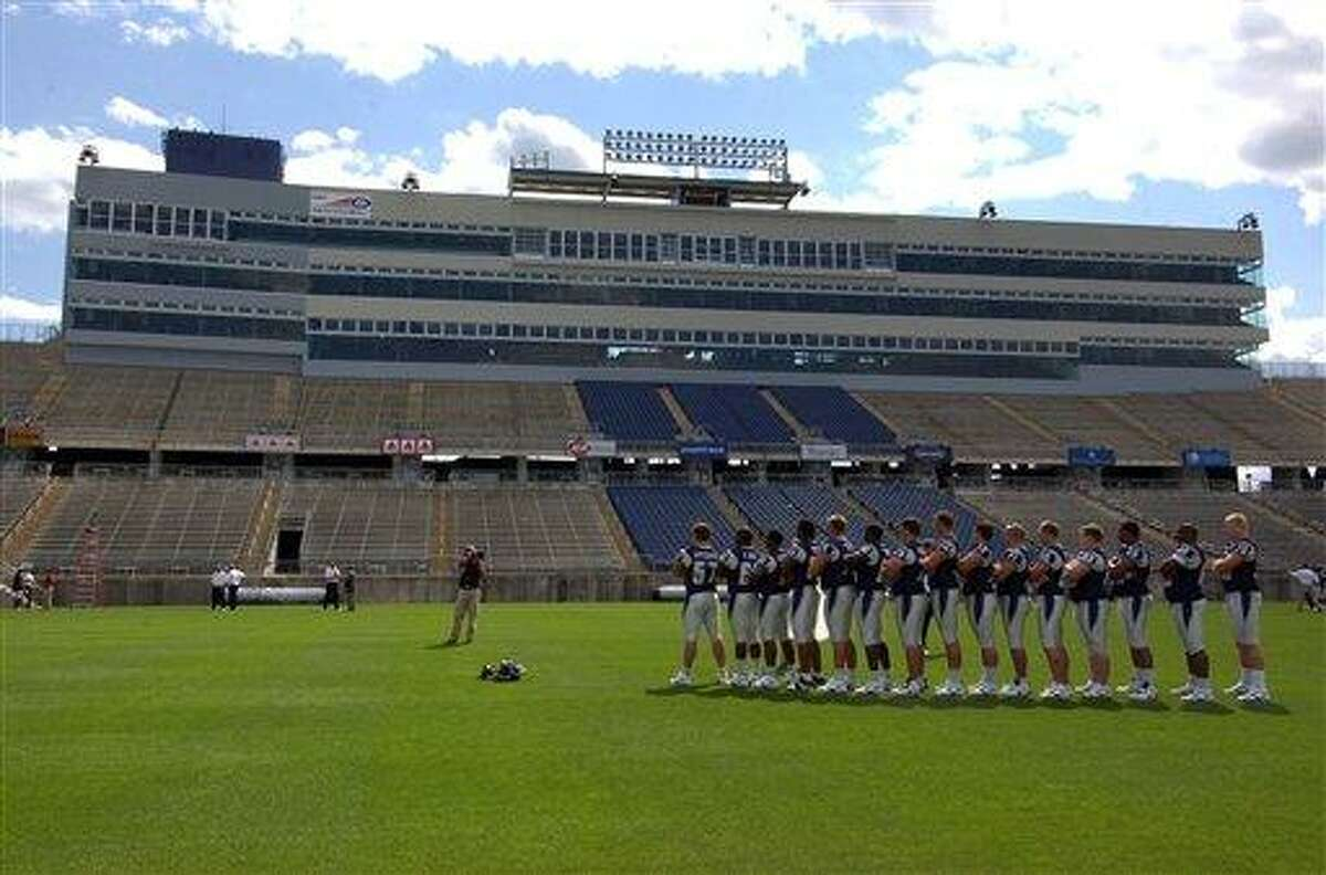 Connecticut football plalyers line up for a photo on media day at Rentschler Field in East Hartford, Conn., Friday, Aug. 11, 2006. (AP Photo/Jessica Hill)