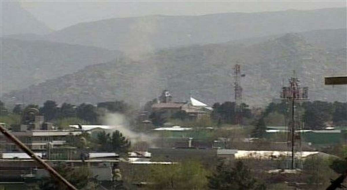 In this image taken from video, smoke rises from Kabul, Afghanistan, following attacks by Taliban militants Sunday. Militants launched a series of coordinated attacks in the Afghan capital Sunday, with blasts and gunfire rocking three neighborhoods that are home to Afghan government buildings, Western embassies and NATO bases. Associated Press