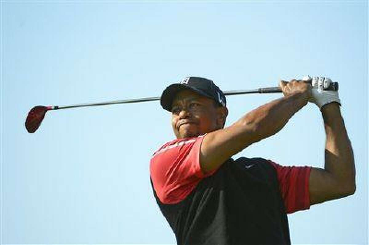 Tiger Woods hits a shot from the third tee during the final round of the Arnold Palmer Invitational golf tournament, Monday, March 25, 2013, in Orlando, Fla.