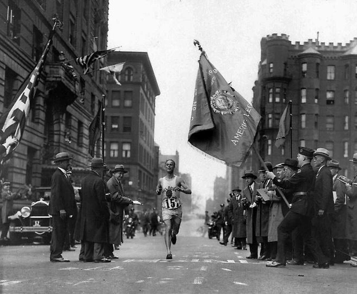 Veteran marathoner Clarence DeMar of the Melrose American Legion Post crosses the finish line April 19, 1930 in Boston, Mass., to win the Boston Marathon for the last of his record seven wins. DeMar's time was 2:34:48.2. Associated Press